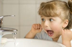 kid flossing