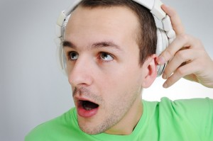 man listening to dental news